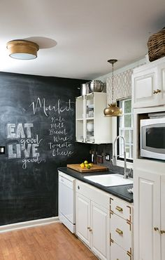 white kitchen + chalkboard wall