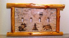 Rustic bear, moose and tree quad outlet switch plate cover on Etsy, $43.00