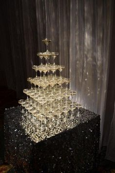 For a glamorous touch inspired by Art Deco glitz and Gilded Age elegance, the wedding specialists at The Ritz-Carlton, Naples recommend presenting your guests with a sparkling champagne tower as the cake is served.