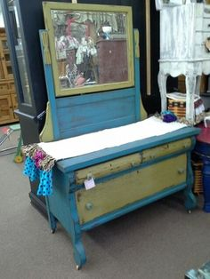 $185 - This solid wood antique dresser has three drawers and the original wood casters as well ad the original mirror. Panted turquoise and marigold with dark wax finish. **** In Booth D8 at Main Street Antique Mall 7260 E Main St (east of Power RD on MAIN STREET) Mesa Az 85207 **** Open 7 days a week 10:00AM-5:30PM **** Call for more information 480 924 1122 **** We Accept cash, debit, VISA, Mastercard, Discover or American