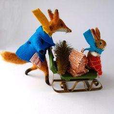 Christmas fox and rabbit on sled