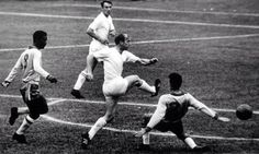 Bobby Charlton gets a shot in against Brazil during the 1962 World Cup