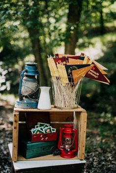 the decor - Vintage lanterns, felt pennants, Polaroid cameras, and apple crates make for an easy DIY. Scavenge your local antique stores for campy souvenirs and remember that pine cones also make great accents. Woodsy Wedding, Camp Wedding, Wedding Blog, Wedding Favors, Wedding Styles, Wedding Decorations, Wedding Ideas, Camping Decorations, Cottage Wedding