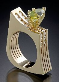 14kt yellow gold design with a marquise Peridot (2.5 carats) and 22 diamonds (approximately 1.00 tw)