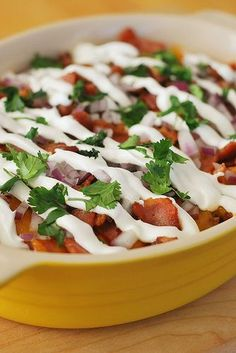 7-Layer Chili Dog Dip - great football food! Layers of chili, hot dogs, bacon, cheese, sour cream, red onion, and cilantro! It is so good!