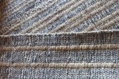 Grey and tan mix mohair carpet in ribbed style.