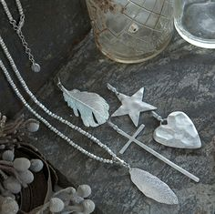 Tutti & Co creates long necklaces with clip on pendants - so clever!  Available to purchase at LBD Boutique is the Feather Pendant with a long silver necklace for £35  LBD Boutique Ships Internationally  http://thelittleblackdressboutique.co.uk/products/227907--tutti-co-feather-pendant-necklace.aspx