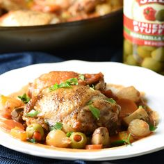 This Chicken Cacciatore recipe is a simple Italian one pot meal with mushrooms, peppers, onion, and olives, braised in a tomato and wine sauce.