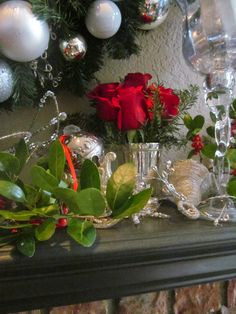 Mint julep cup, silver bells and red roses.