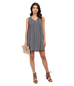 ; Turn up the attitude with this sweet Mikaela Babydoll Dress. ; Feminine babydoll dress flaunts a modern print allover for an edgy flair. ; V-neckline. ; Sleeveless feature. ; Gathering at babydoll yoke. ; Straight hemline rests at a flirty length. ; 100% rayon. ; Hand wash cold, dry flat. ; Imported. Measurements: ; Length: 34 in ; Product measurements were taken using size SM (US 4). Please note that measurements may vary by size.