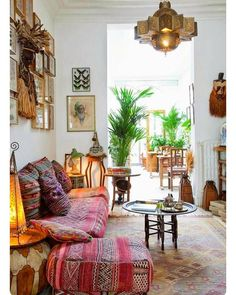 Inspiration: Moroccan interior design. Loving everything about this photo! The colours, couch, the plants, the lamp and the pouffes Via #pinterest