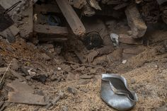 The body of a victim of the earthquake that hit Nepal yesterday lays underneath debris from one of the collapsed buildings on April 26, 2015 in Bhaktapur, Nepal.