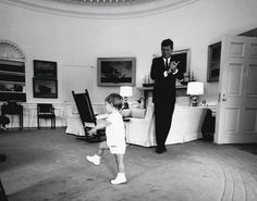 JFK claps for his son