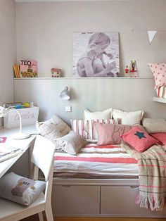 For large families, or where space isn't available, sharing a bedroom is a necessity. This shared bedroom shows that you can incorporate spacesaving desgin - even in a small room