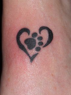 I want this Tattoo except the heart would be pink and the paw would be zebra print :)