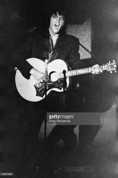 Rock 'n' roll singer and actor Elvis Presley (1935 - 1977) performs at the Las Vegas International Hotel, August 1969.
