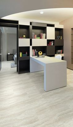 Monochrome home office using Ivory Travertine luxury vinyl tile flooring from the Cavalio Conceptline range