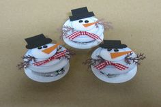 Peppermint Patty Snowmen-----I bet the Trader Joes Blue wrapped round mints would look so cute with these
