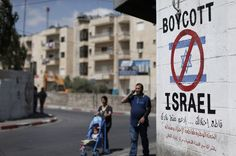 A sign in Bethlehem, in the West Bank, calls for a boycott of products from Israeli settlements in the occupied territories.
