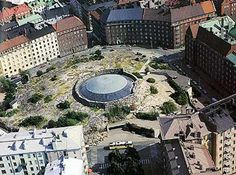 BETWEEN  Temppeliaukio (Rock) Church in Helsinki by Timo and Tuomo Suomalainen, 1969  The church is inserted below grade within a depression in the rocky landscape. The interiors are left exposed showing the rock faces.
