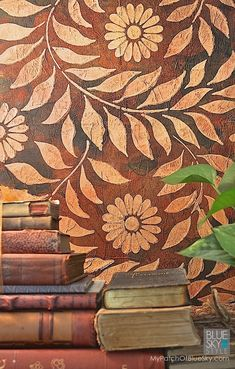DIY home decor project to try - Layer texture and pattern using Wood Icing® Textura Paste Plaster for aged, antique, raised pattern with floral wall art stencils