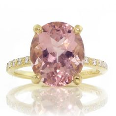 Brides.com: Engagement Rings with Colored Stones. Style gr152, morganite and diamond ring in 18K yellow gold, $3,800, Adel Chefridi  See more oval-cut engagement rings.