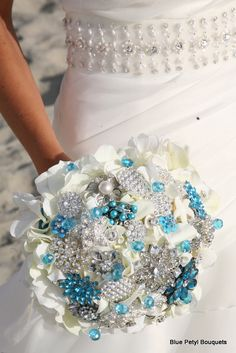 Turquoise Hydrangea Bouquet #BroochBouquet  Using a flower for the base to build off of and support the jewels.