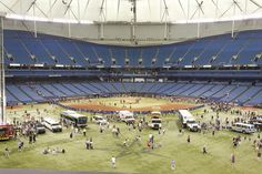 """We had our first ever """"Field of Wheels"""" event at the Trop on Sunday May 20th. After the game fans had the opportunity to come on the field and interact with an array of vehicles from fire trucks to a horse and carriage."""