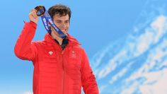Sandro Viletta Swiss alpine skier Sandro Viletta celebrates with his gold medal during the men's super-combined Medal Ceremony.