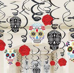 These fabulous sugar skull hanging decorations would look great at a Halloween, or Dia de Muertos party. Just hang them from your ceiling or window frame for an instant spooky effect. Hanging cutouts feature floral and cobweb sugar skulls, and beautiful red roses. Sugar skull Day of the Dead swirl decorations include: 14 Foil swirl decorations 8 Foil swirl decorations with 12cm cut-outs 8 Foil swirl decorations with 17cm cut-outs