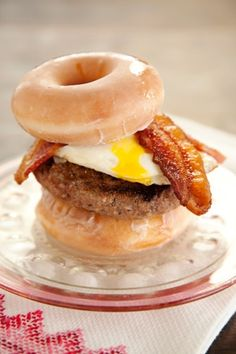 I love Paula Deen, but here is that infamous donut hamburger. Everything in moderation... I guess. I could never do this.... too much... I couldn't even eat 1/6 of this.