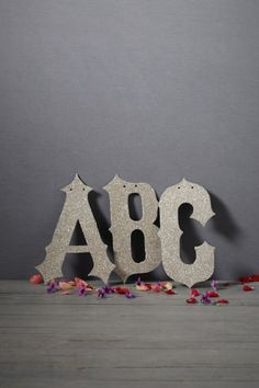 giant glittered letters in silver by wendy addison from bhldn Bhldn Wedding, Vintage Inspired Wedding Dresses, Name Wall Art, Glitter Letters, Sparkle Wedding, Letters And Numbers, Metal Letters, Table Numbers, Planner