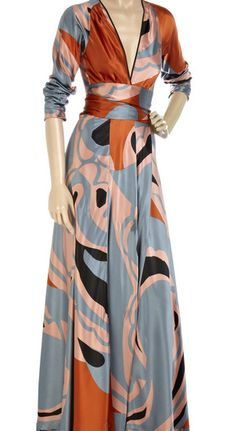 Ossie Clark silk dress.  I'm not sure quite what it means to be producing new fashions in the name of a deceased designer, but I love this print.