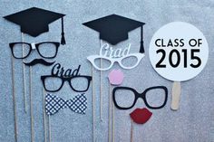 Last-Minute Graduation Party Ideas -  graduation photo booth prop set grad caps classes signs