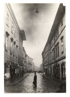 "This book took place in Kraków, Poland in the 1930's, during World War 2, when the Nazis invaded Poland. This city was later walled in, and became known as the Krakow ""ghetto"", as it was described in the story."