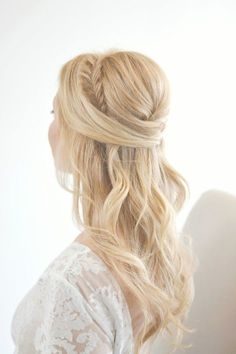 If you're struggling through possible wedding hair ideas, know that you can't go wrong with the classic half up, half down option!