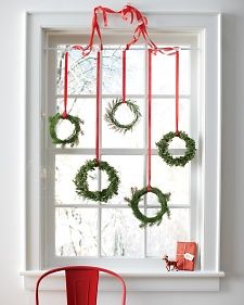 simple green wreaths for Christmas (love the red chair)