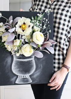 Flower Power  If you love having a vase of flowers in your home all year long, this DIY is perfect for you. Combine a canvas and faux flowers to make a one-of-a-kind work of art. Whether you go with a simple painted look or a fun and trendy chalkboard style, this artwork will make your guests do a double take.