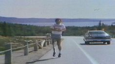Terry Fox is escorted by a police cruiser during his Marathon of Hope run in 1980.