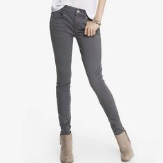 """Express Gray Mid Rise Extreme Stretch Jean Legging Extreme Stretch fabric gives this mid rise jean legging a comfy fit and scads of curve appeal. The cool neutral gray makes it a winner for styling versatility and perfect for any less-than dressy occasion. * Mid rise jean legging, 30 1/2"""" inseam * One button closure with zip fly * Five pocket styling, back pocket stitching detail * Clean gray rinse * Cotton/Polyester/Lycra® spandex * EUC condition, worn once Express Jeans Skinny"""