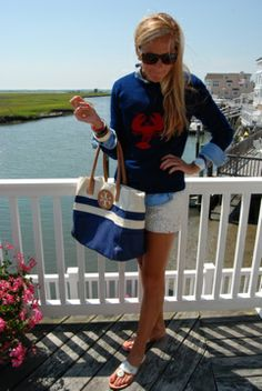 Cute way to wear my new lobster sweater. White sandals and shorts with a chambray top.  Navy and white tory burch tote. Jack Rogers sandals