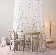 a canopy bedecked with metallic dots sets a magical scene. #rhbabyandchild