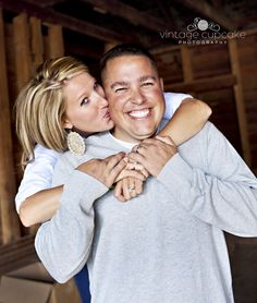 husband and wife kissing in old barn for Family fall photo session Denver, Colorado Family and Child Photographer The Vintage Cupcake Photography