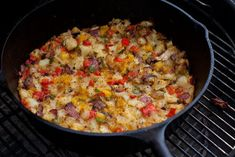Grilled home fries recipe in a cast iron skillet. Grill some potatoes and peppers and have an amazing grilled brunch.