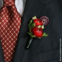 Ranunculous and fern curl boutonniere