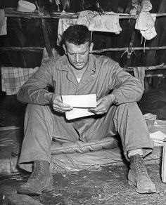 Enogai Inlet, New Georgia Islands, September, 1943.Col. Harry Liversedge, Commanding Officer of the Marine Raiders, reads his first letter from home since he went into action. Regarded as one of the greatest combat leaders in Marine Corps history, in 1945 he led his Combat Team 28 to the top of Mount Suribachi on Iwo Jima, an event made famous by Joe Rosenthal's iconic image of the flag being raised by five Marines and a Navy medic.
