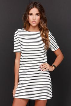 A little trouble can be a lot of fun with the Law Bender Black and Ivory Striped Dress by your side! A casual t-shirt style shift dress with a rounded neckline and modest half sleeves takes shape in a soft knit, boasting black stripes over a chic ivory backdrop. Unlined. 65% Cotton, 35% Polyester. Hand Wash Cold. Imported.