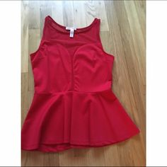 Sexy red peplum top Sexy red peplum tank top with mesh lining at the top(and back) and going down the front. Perfect for the holidays or just a night out. Only worn once to try on. Gives a beautiful shape Tops Tank Tops