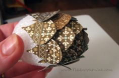 ornament | ... half-covered, stop and tack on a loop of ribbon (about 8-10 inches