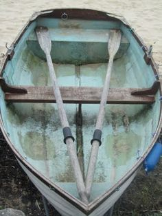 Always wanted an old broken down boat in my yard. and i love the style of light turquiose/tiffanie blue over wood and grey paint